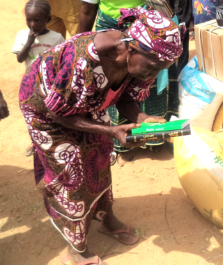 Nigeria Refugee Camp Blog Image-Woman Receives Bible